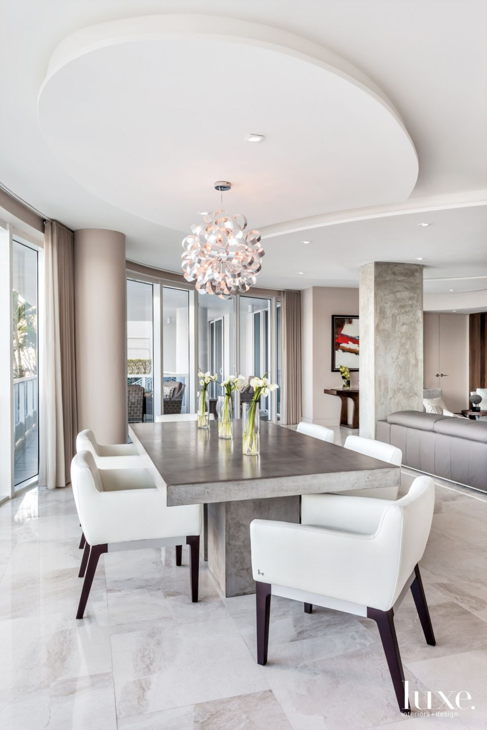 Grey and White Dining Room in Eclectic Fort Lauderdale Condo