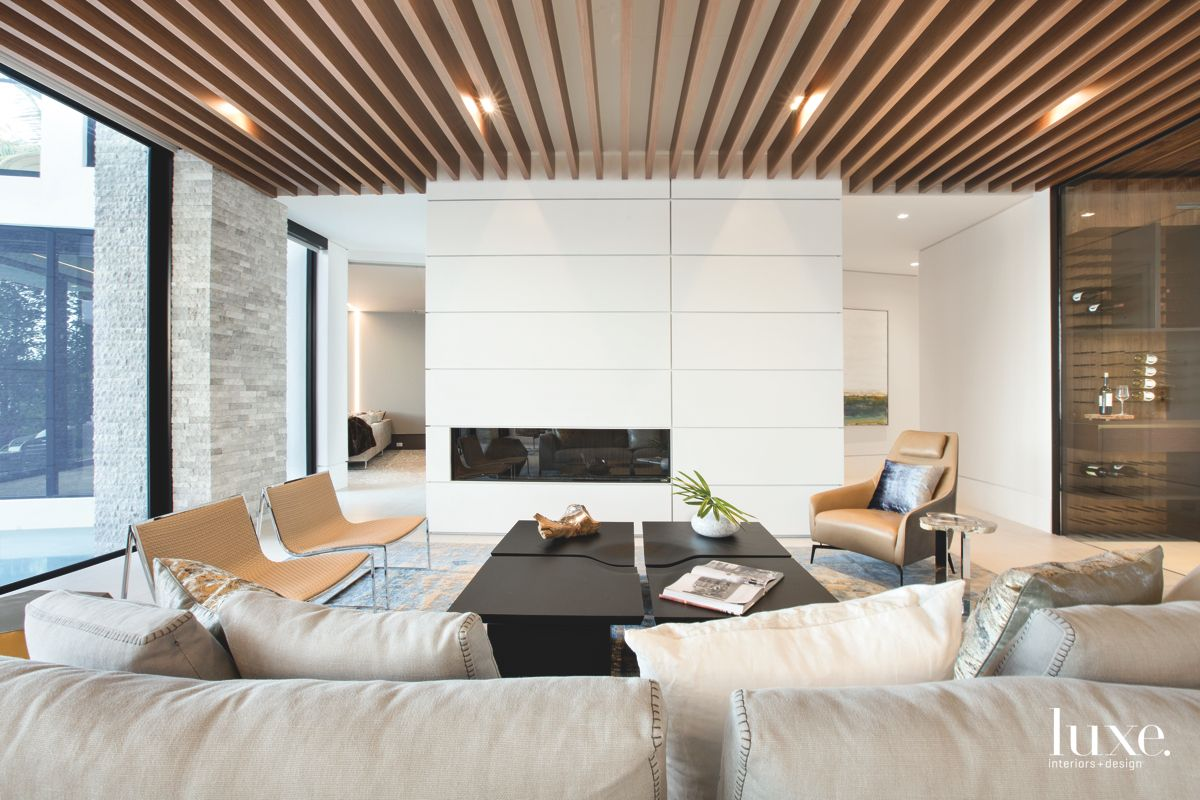Slatted-Wood Ceiling & Metal Fireplace Define Contemporary Fort Lauderdale Living Room