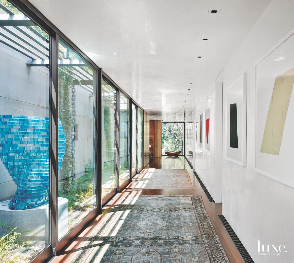 Light-Filled San Antonio Hallway With Walls of Art and Windows