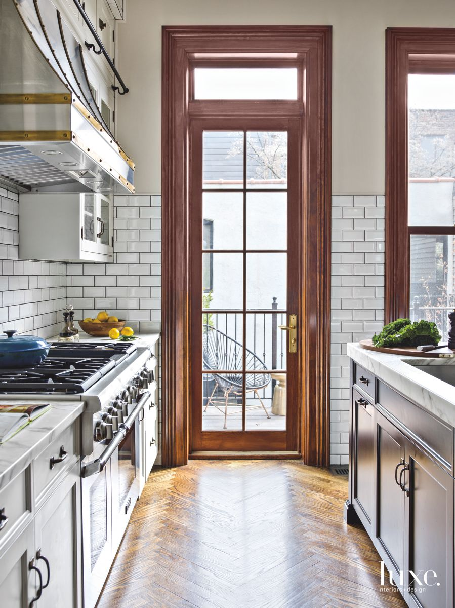 White Subway Tiles With Charcoal Grey Grout Add to Vintage Appeal of Chicago Row House Kitchen