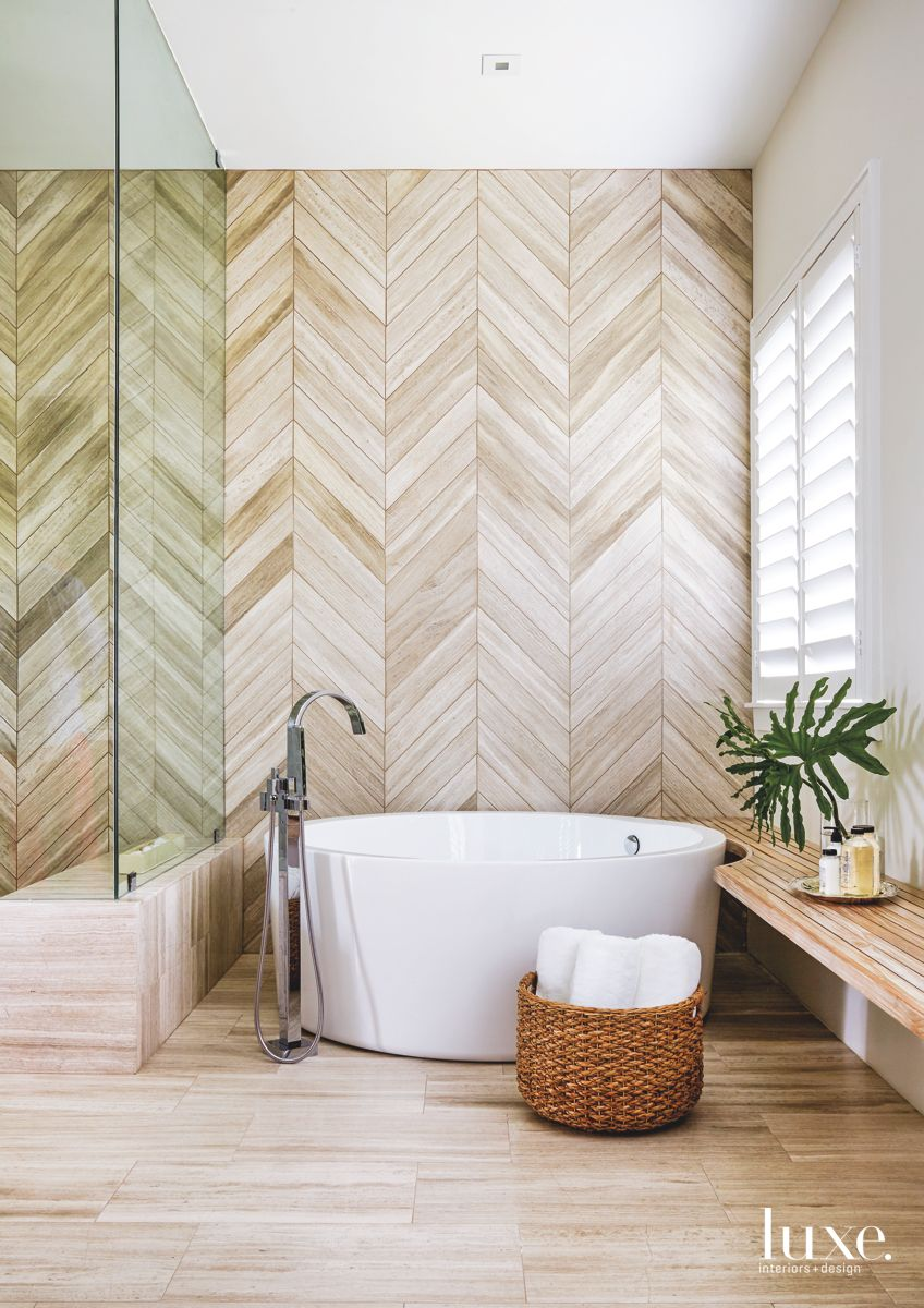 Miami Master Bathroom Makes A Statement With Herringbone Marble Tiles