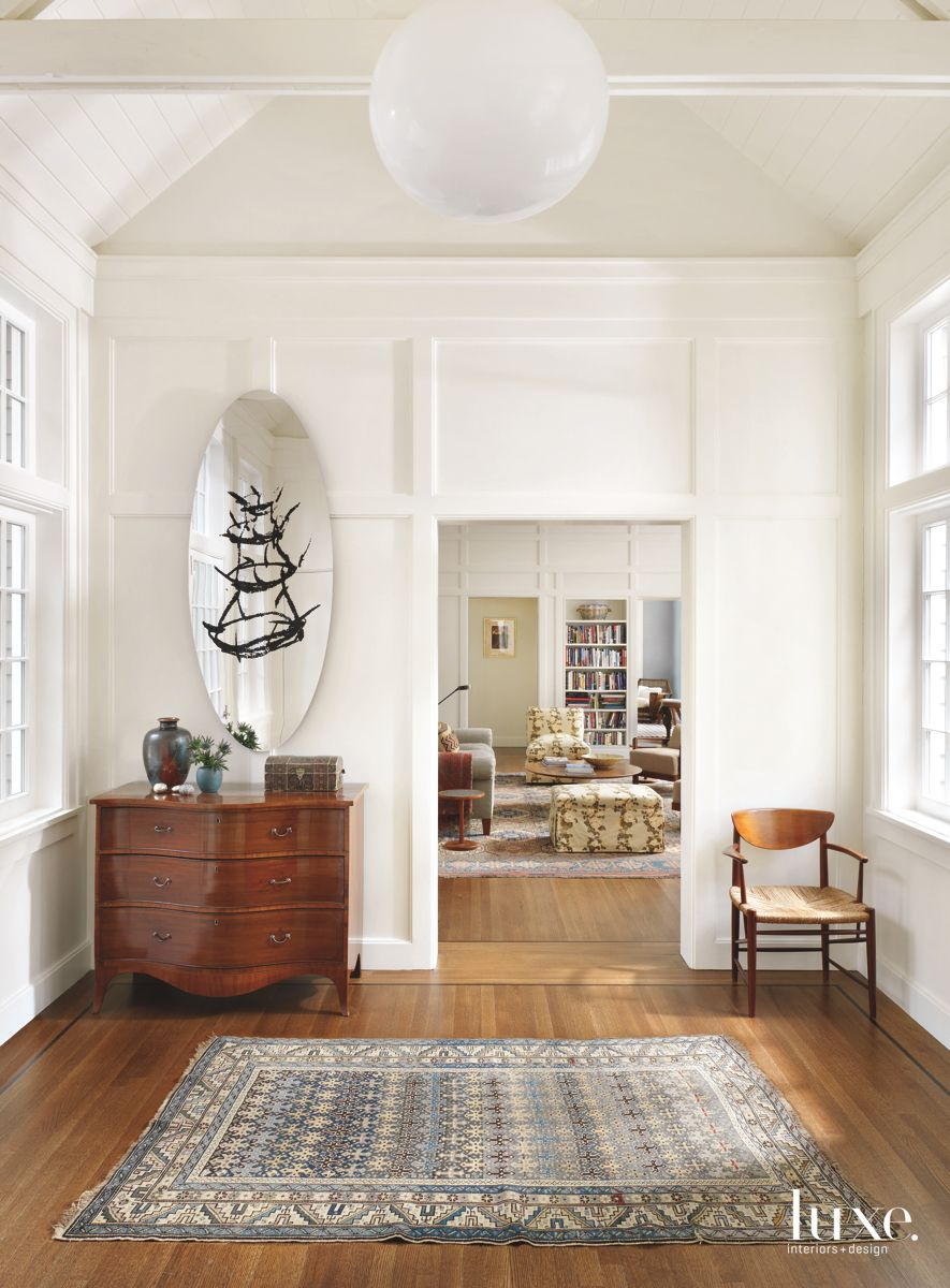 Gracious All-White Foyer with Eclectic, Modern Touches on Long Island's Gold Coast