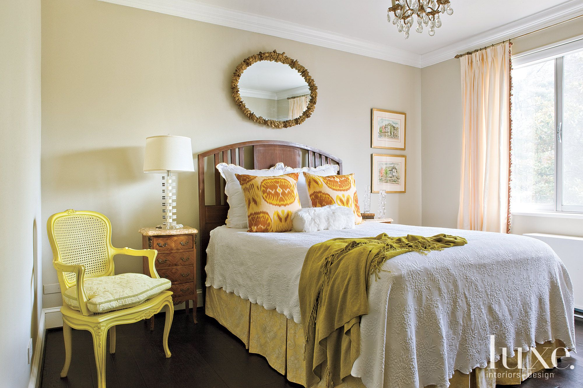 Eclectic Yellow Bedroom with Oval Mirror