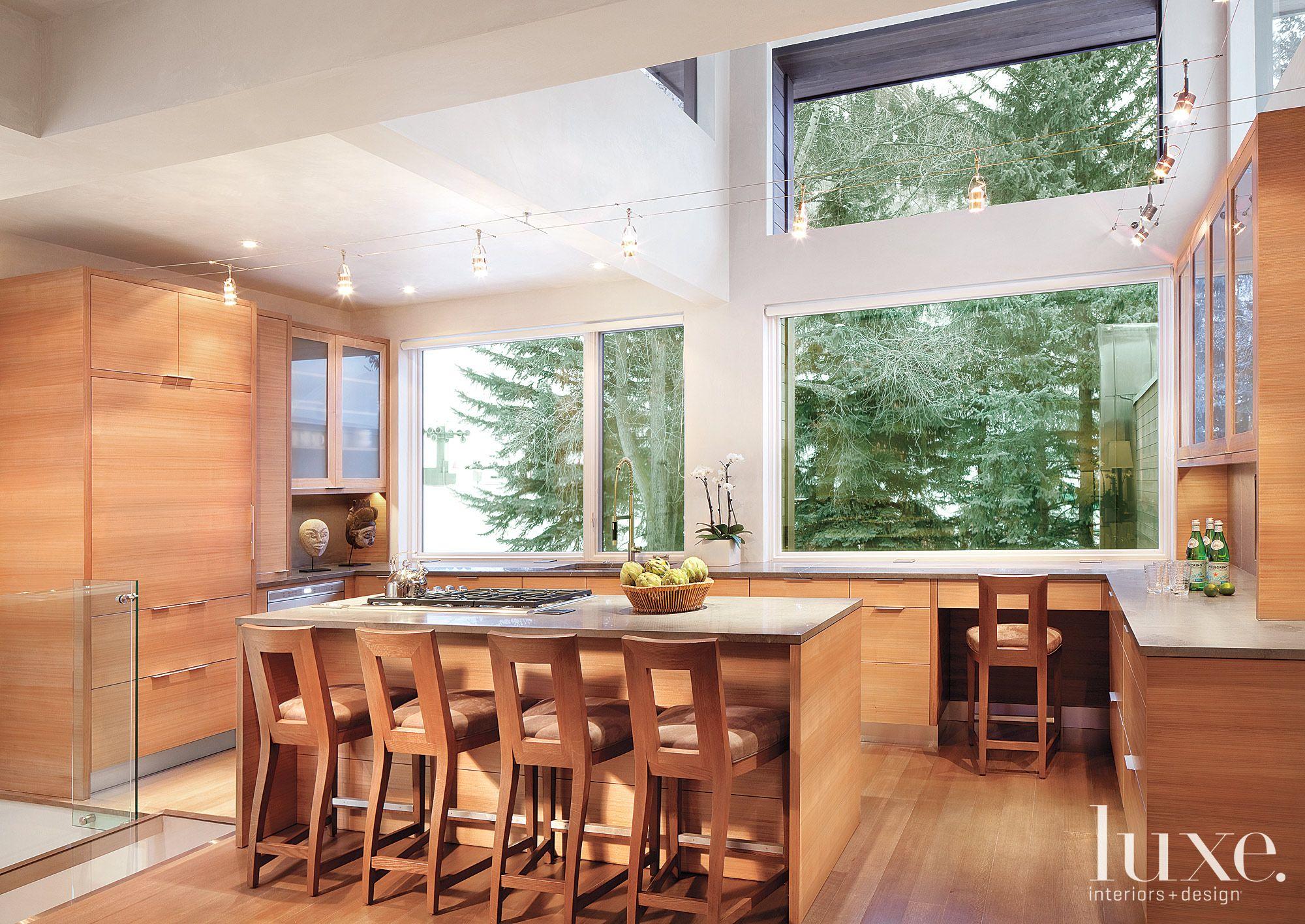 Modern Neutral Kitchen with Walnut Cabinetry