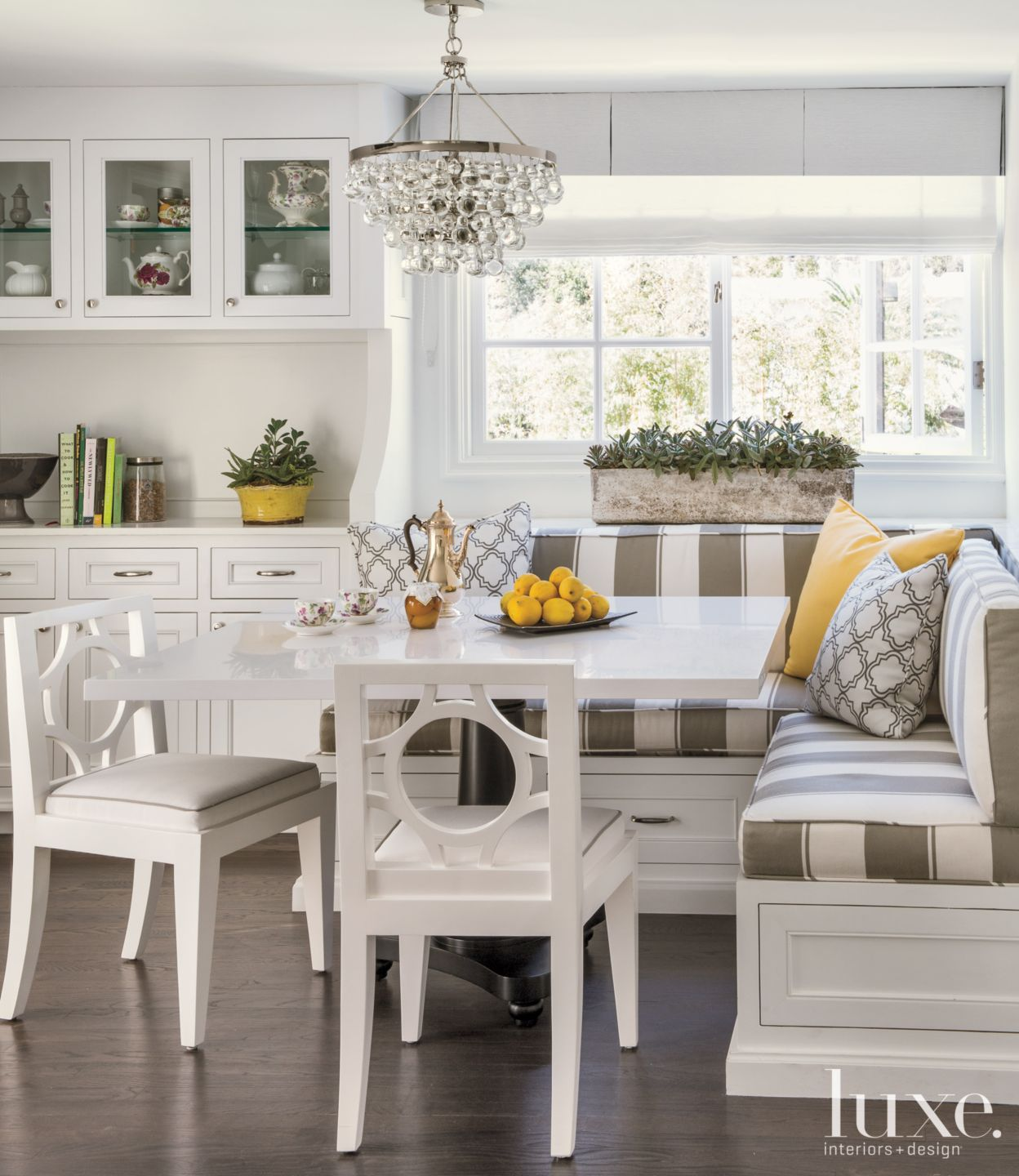 Transitional White Breakfast Nook with Striped Banquette Seating
