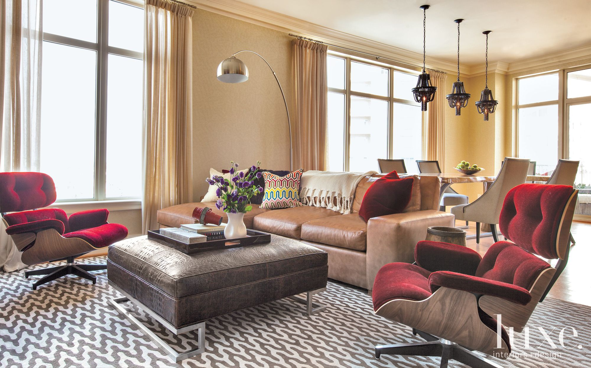 Modern Neutral Living Room with Burgundy Lounge Chairs
