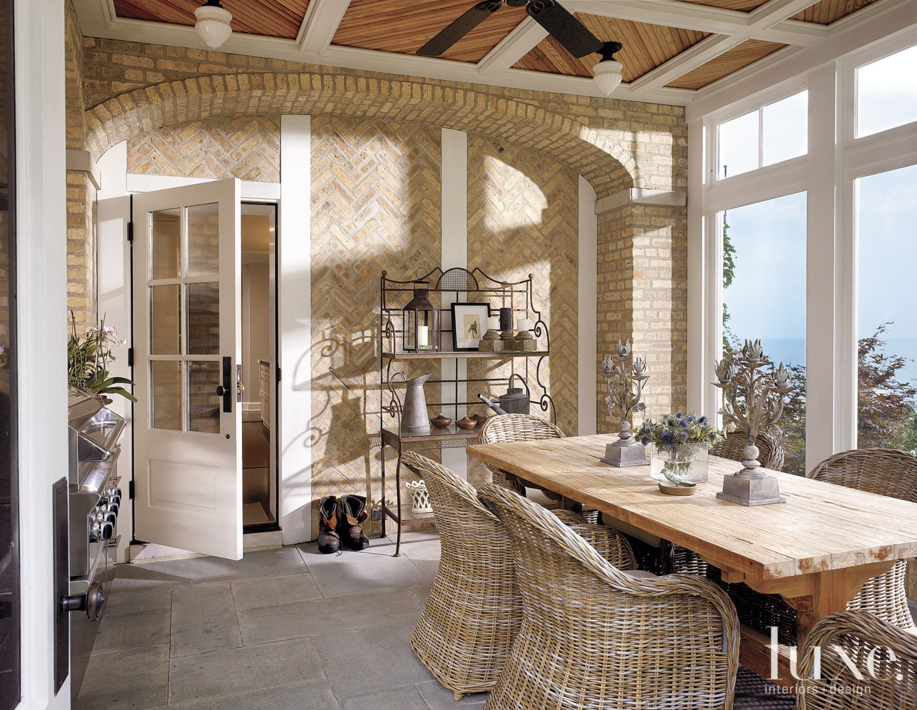 Contemporary Neutral Indoor Patio with Picture Windows
