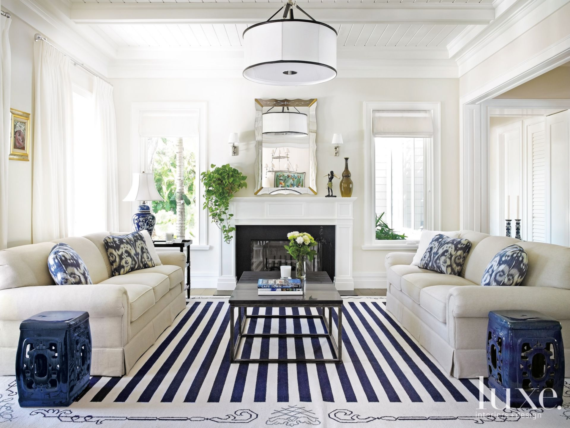 Transitional White Living Room with Dark Blue Accents