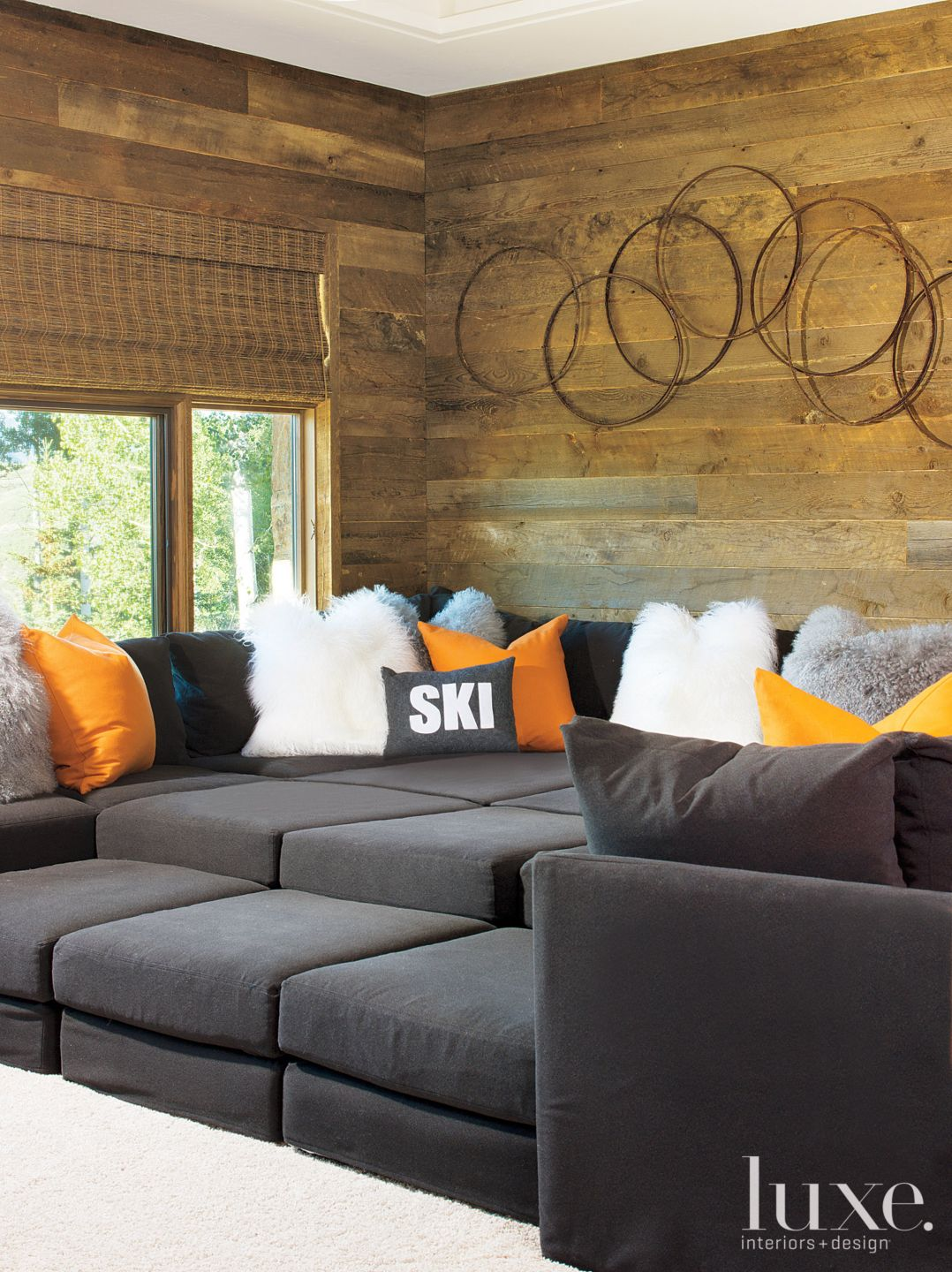 Mountain Neutral Media Room with Black Sectional