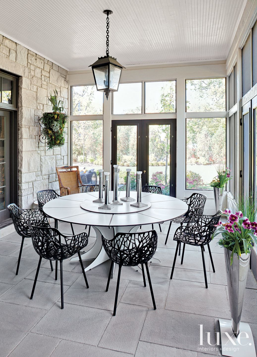 Contemporary Neutral Outdoor Dining Space with Stone Exterior