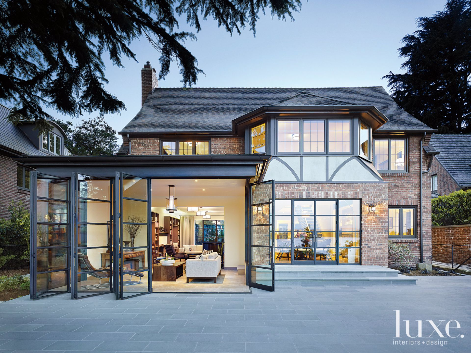 Transitional Neutral Tudor Exterior with Steel Windows