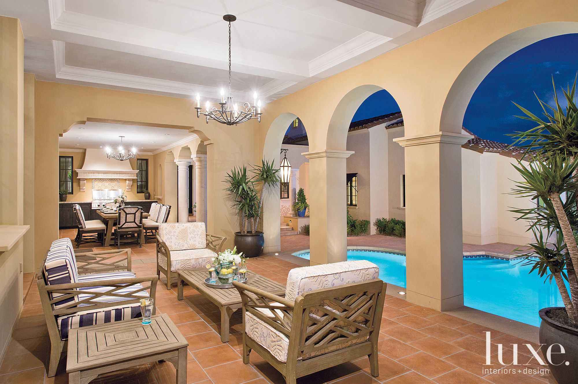 Traditional Neutral Poolside Area with Terra-Cotta Tiles