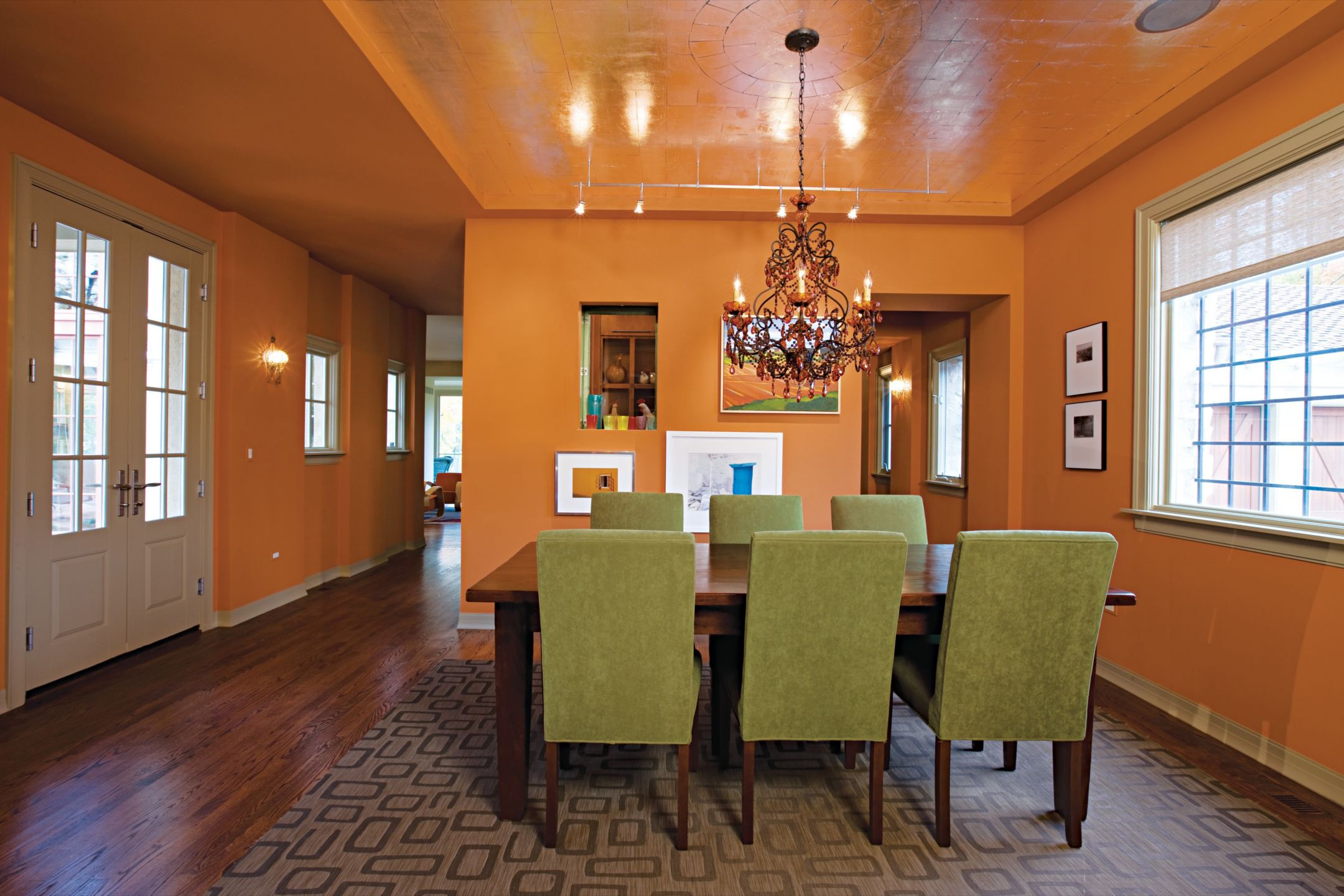 Country Orange Dining Room with Green Dining Chairs