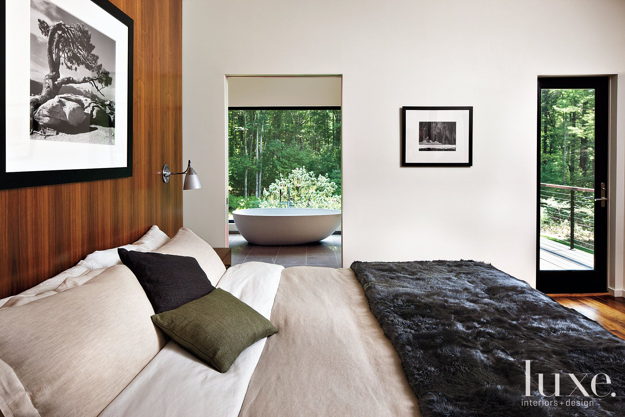 Contemporary Master Bedroom with Wooden Accent Wall