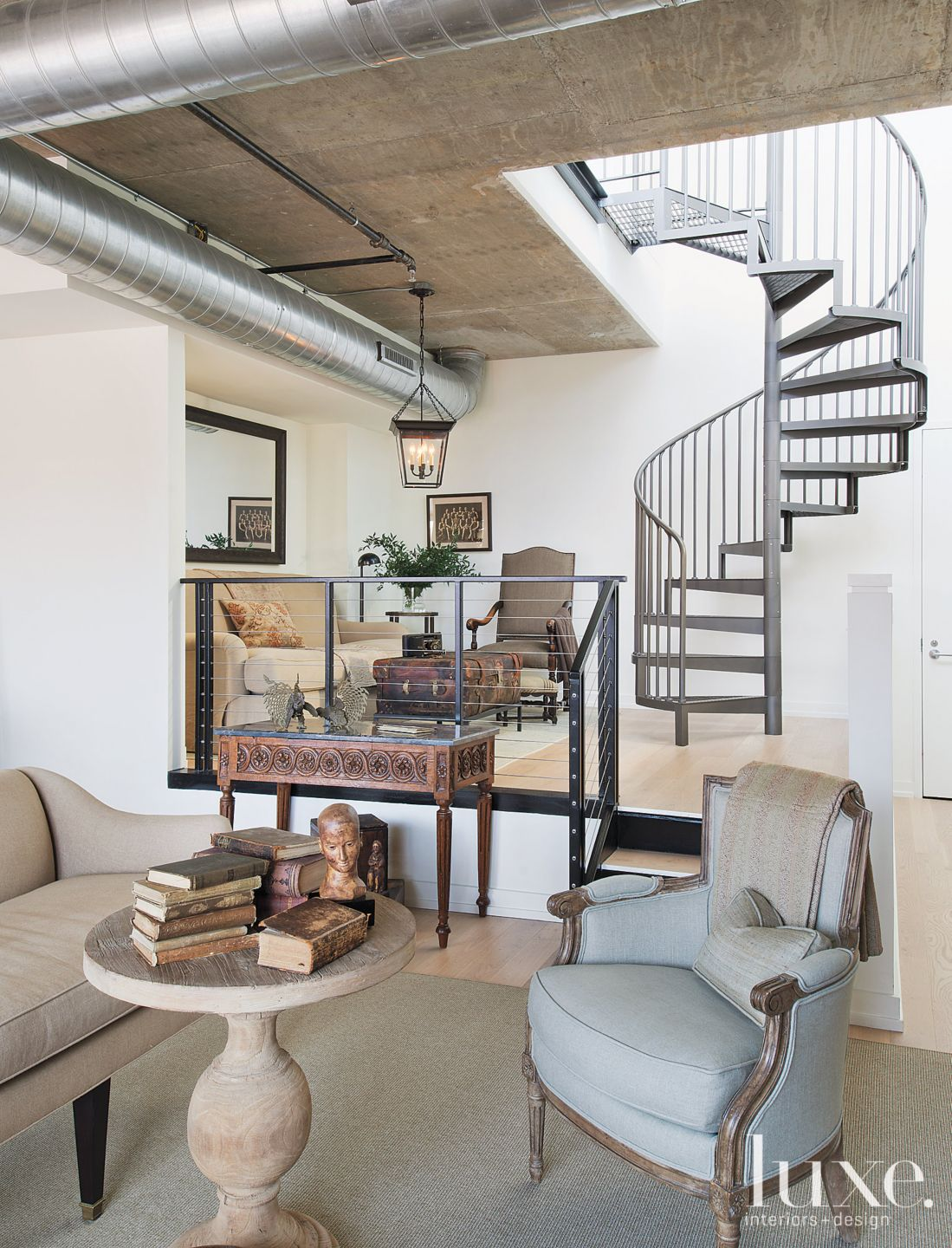 Neutral Eclectic Living Room with Industrial Ceiling