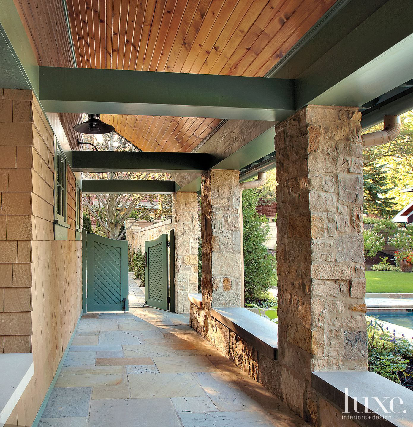 Traditional Neutral Covered Walkway with Green Doors