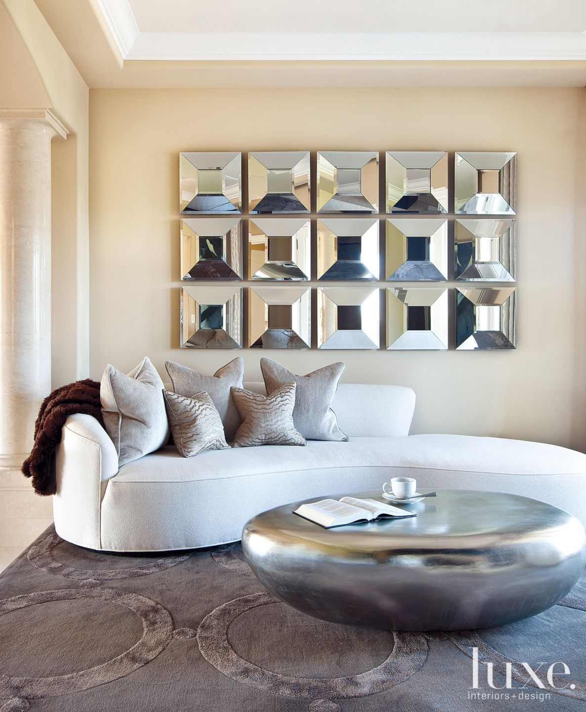 Contemporary Neutral Bedroom Sitting Area with Wall Installation