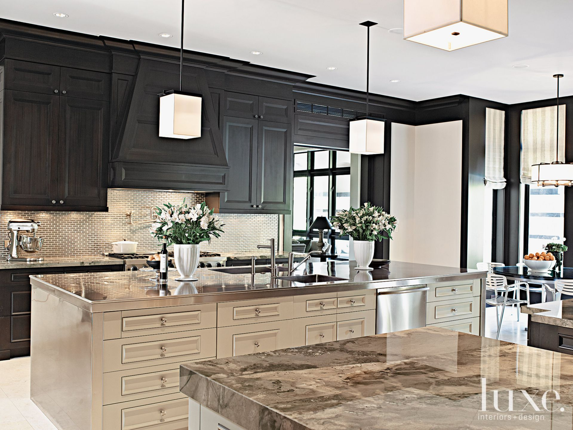 Contemporary Cream Kitchen with Geometric Pendants