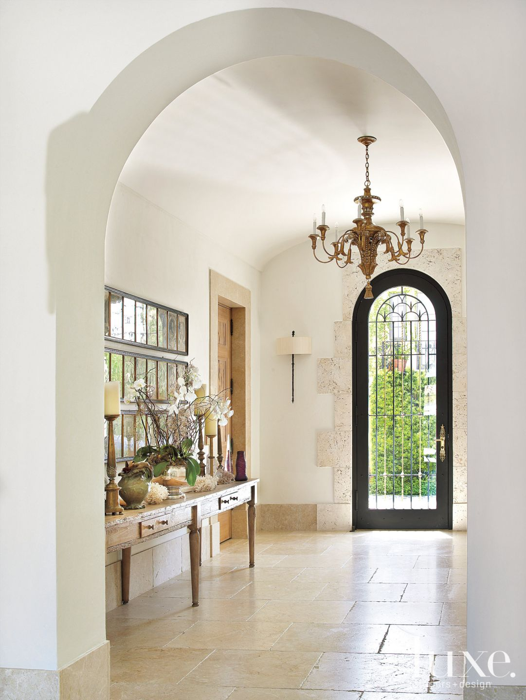 Mediterranean White Entry Hall with Marble Flooring