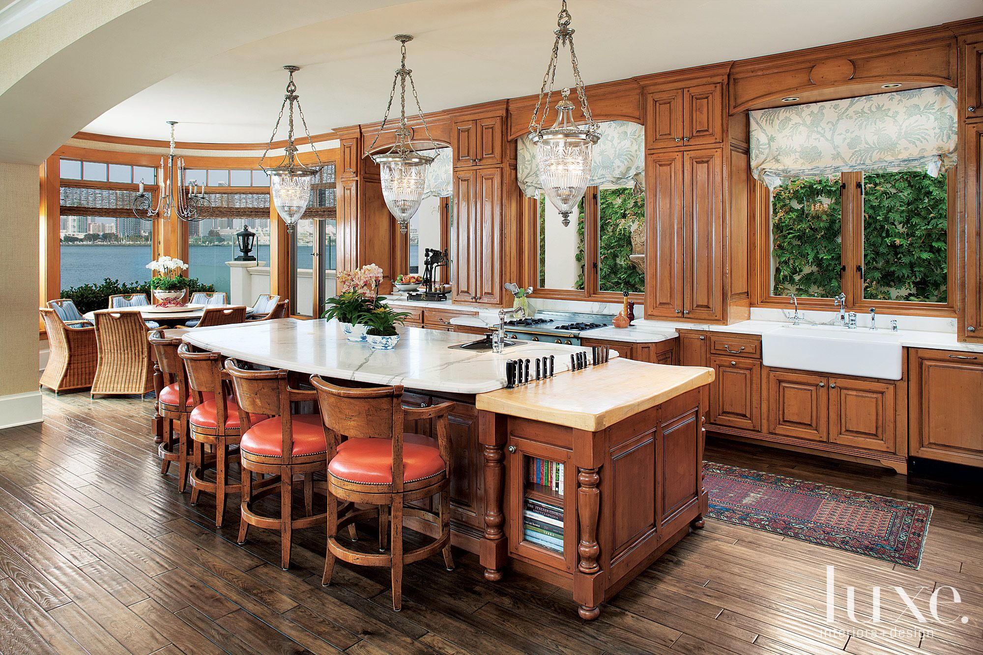 Traditional Kitchen with Orange Stools