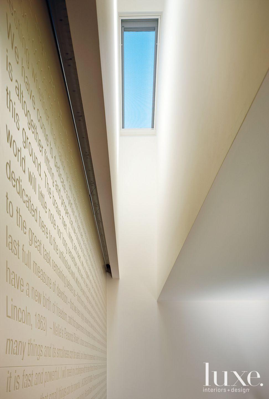 Contemporary Skylight Above Cream Stairway