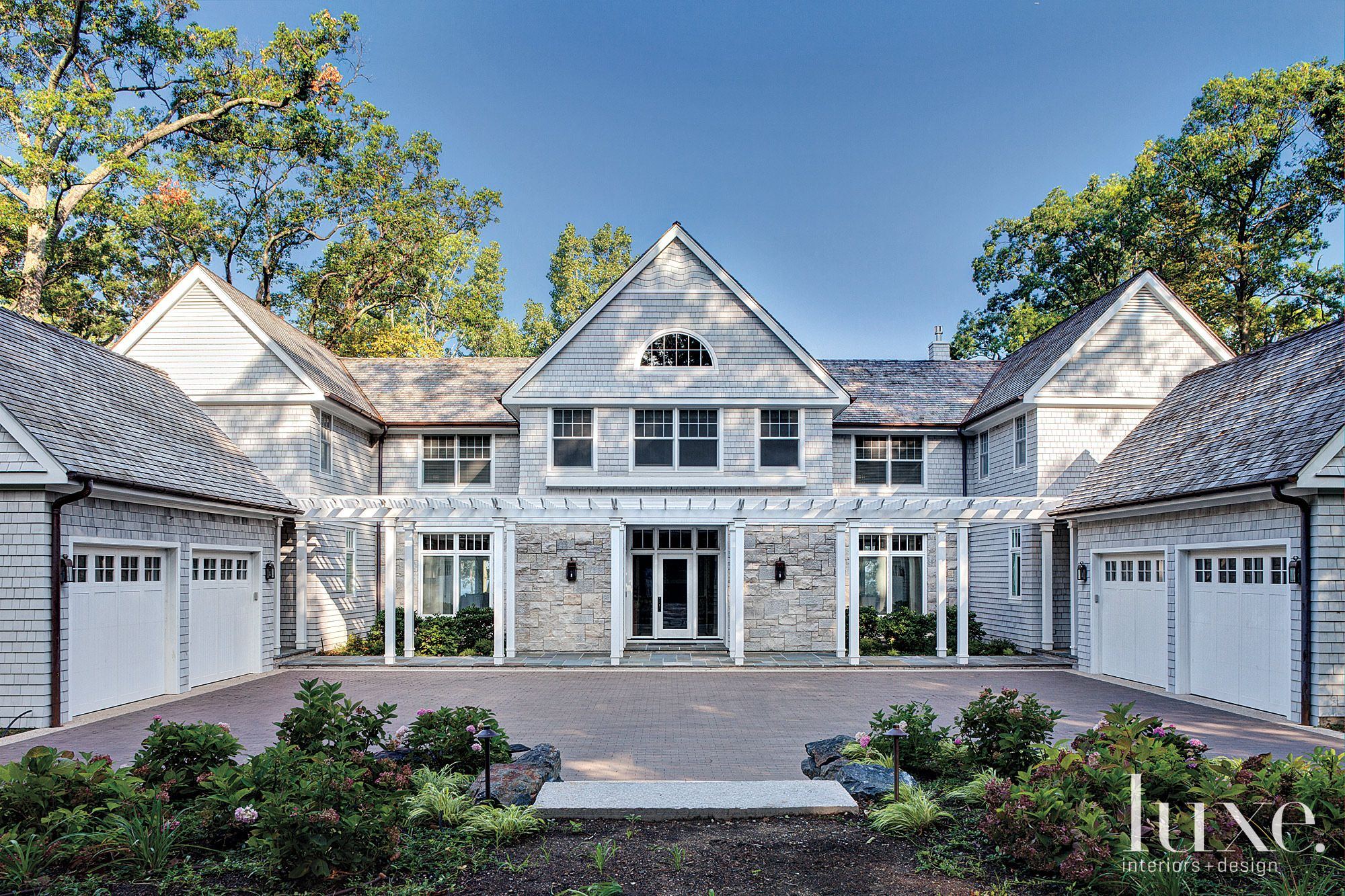 Contemporary Neutral Front Elevation with White Pillars