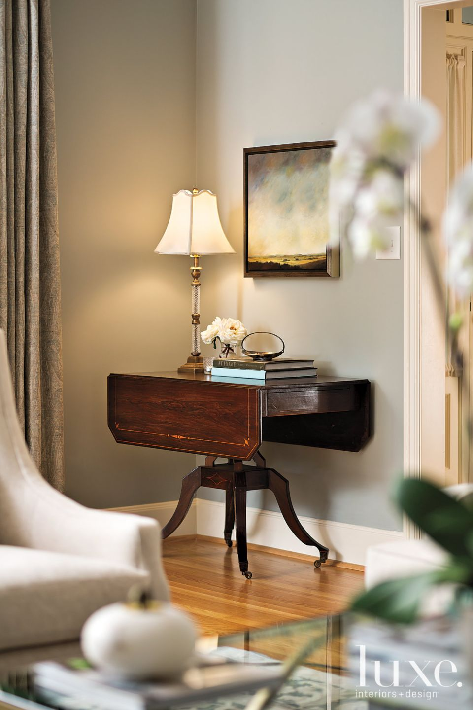 Transitional Neutral Living Room Vignette with Lamp-Lit Painting