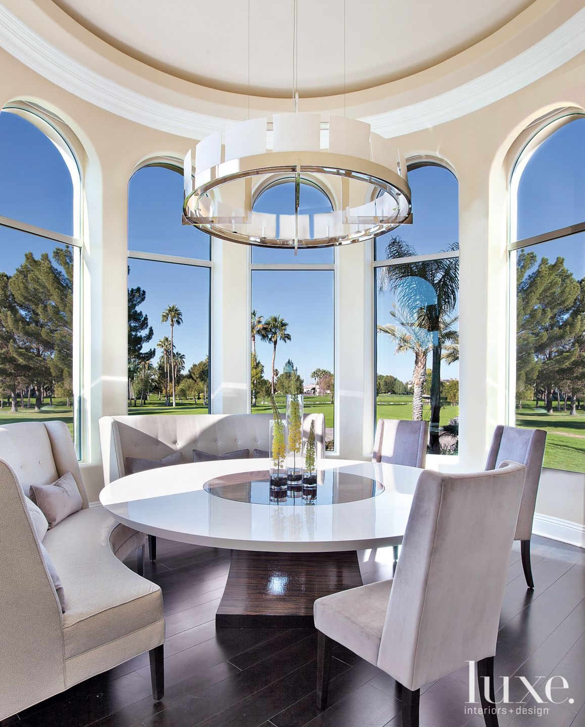 Contemporary Neutral Dining Room with Arched Windows