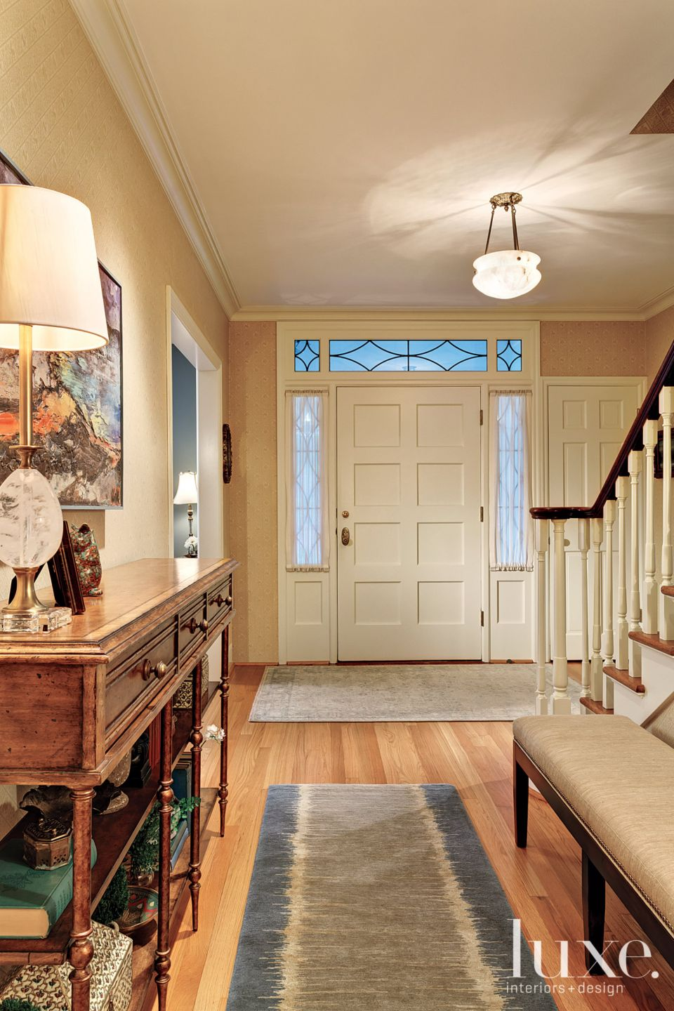Transitional Neutral Foyer with Patterned Runners