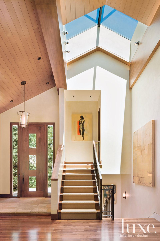 Contemporary Neutral Foyer with Custom Walnut-and-Bronze Door