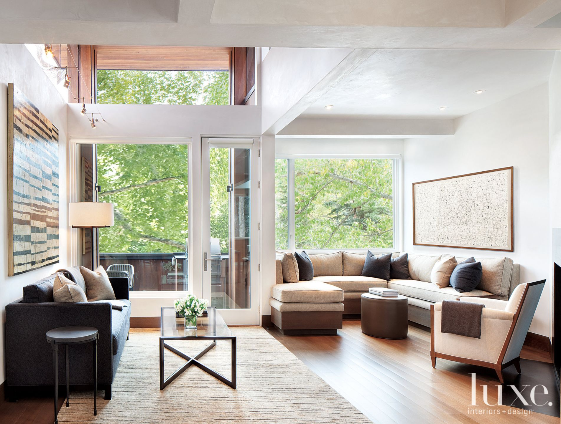 Modern Neutral Living Room with Wall-Backed Sectional