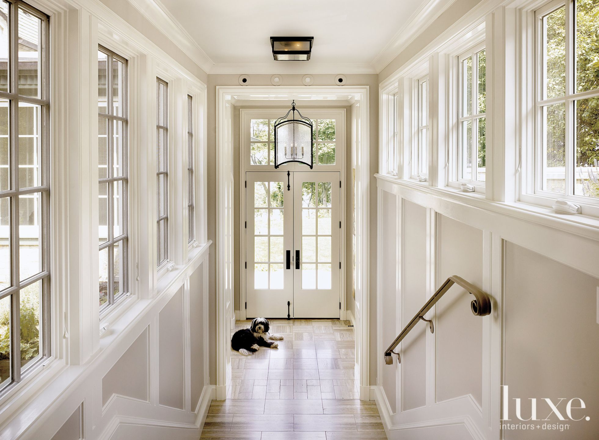 Contemporary Cream Breezeway with French Windows and Doors
