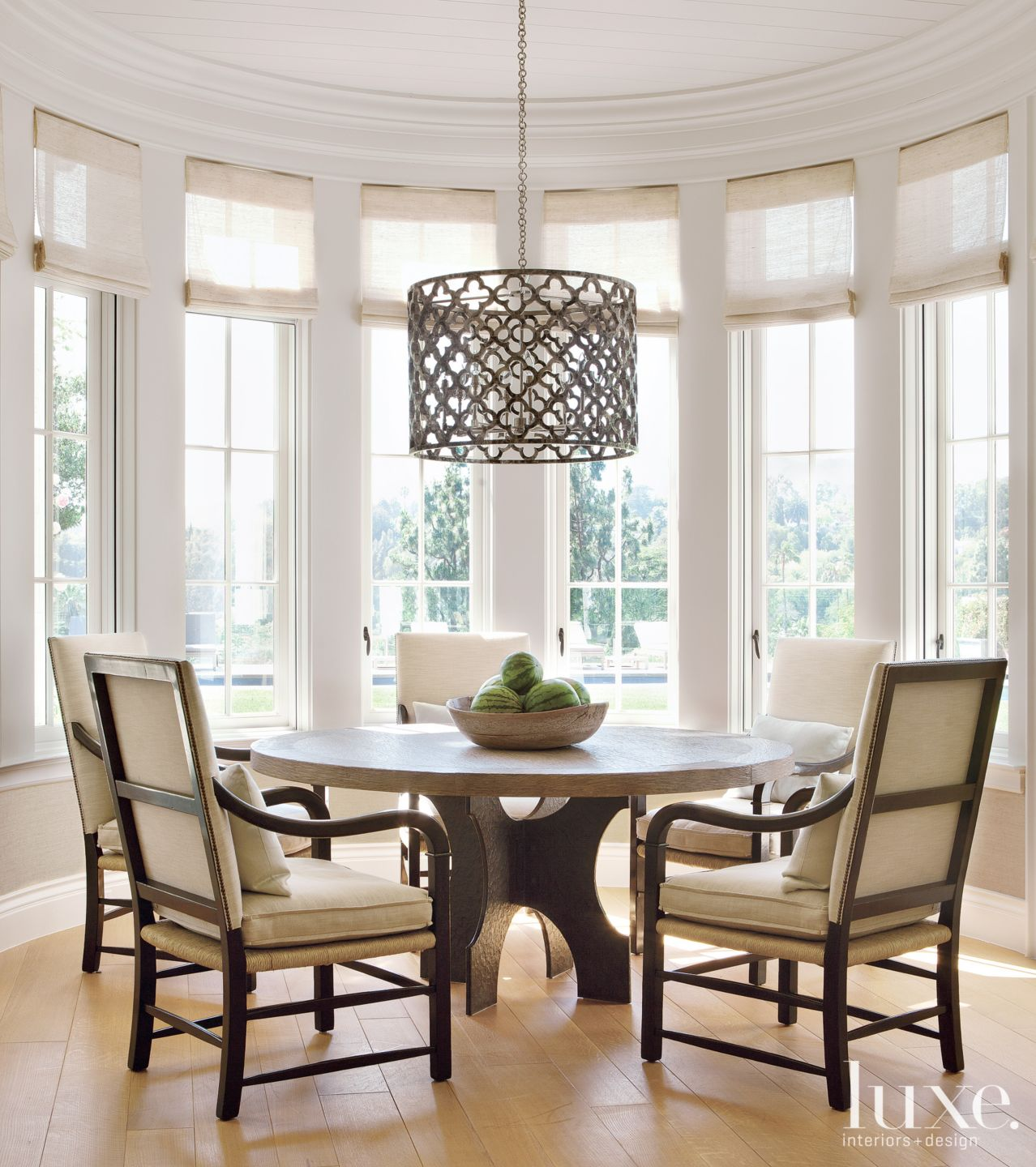 Transitional White Breakfast Nook with Patterned Pendant