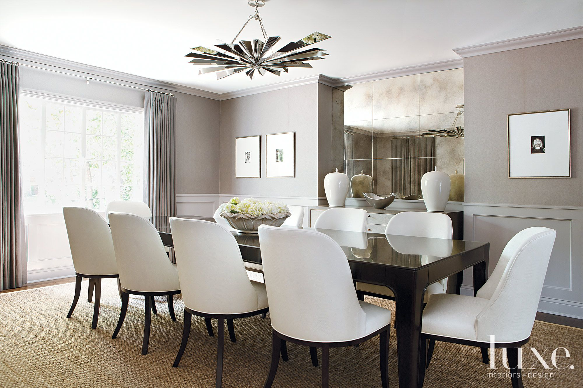 White Dining Room with Mirrored Feature Wall
