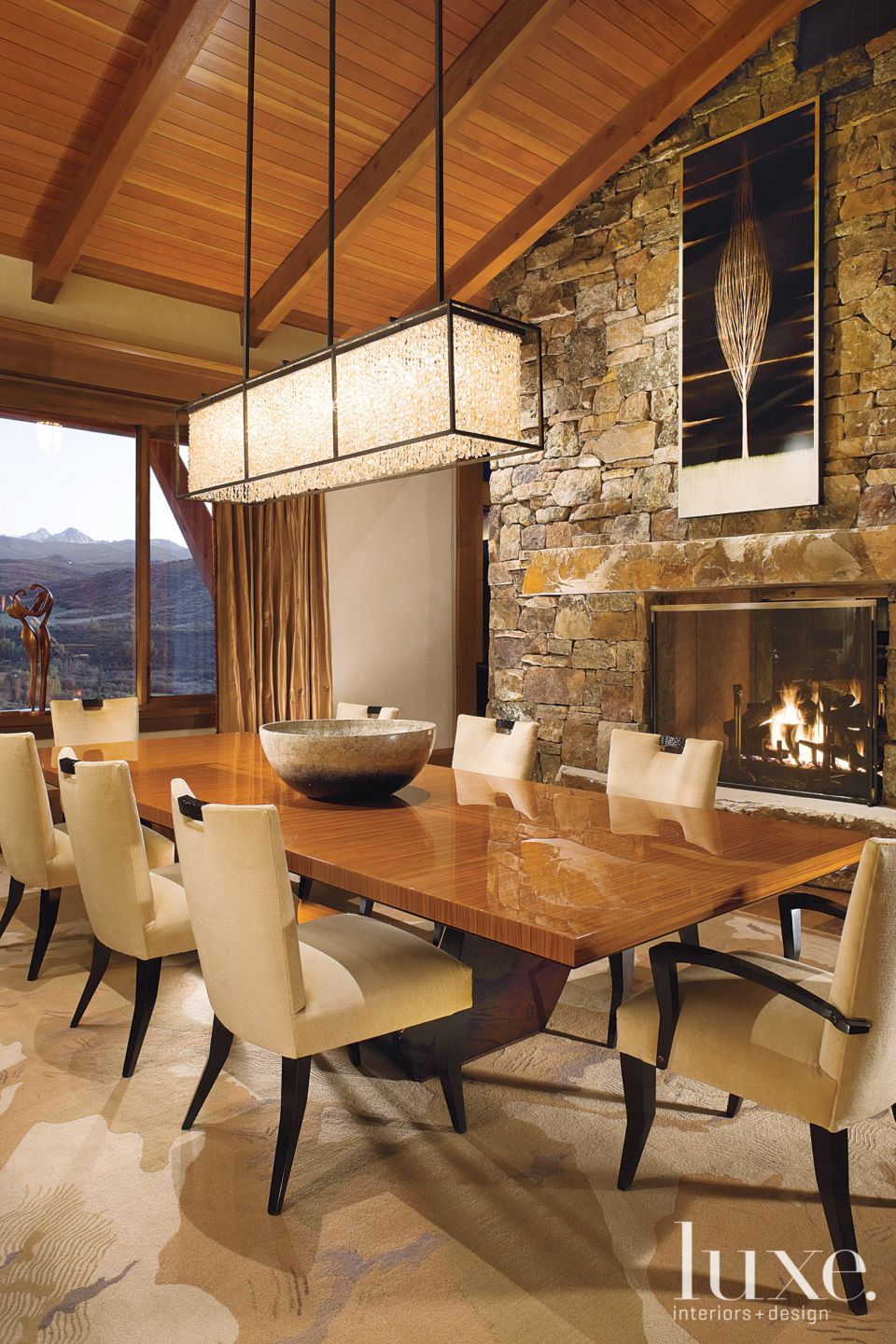 Mountain Neutral Dining Room with Moss Rock Fireplace