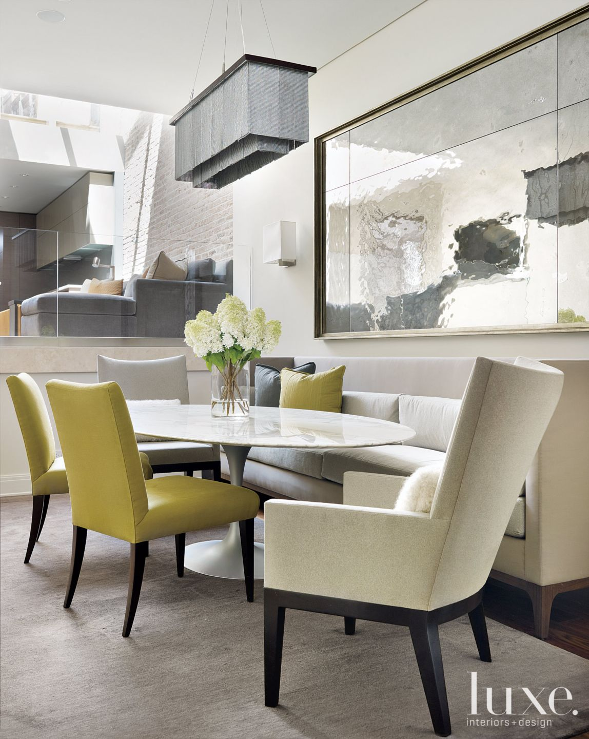 Contemporary Cream Dining Room with Green Linen Chairs