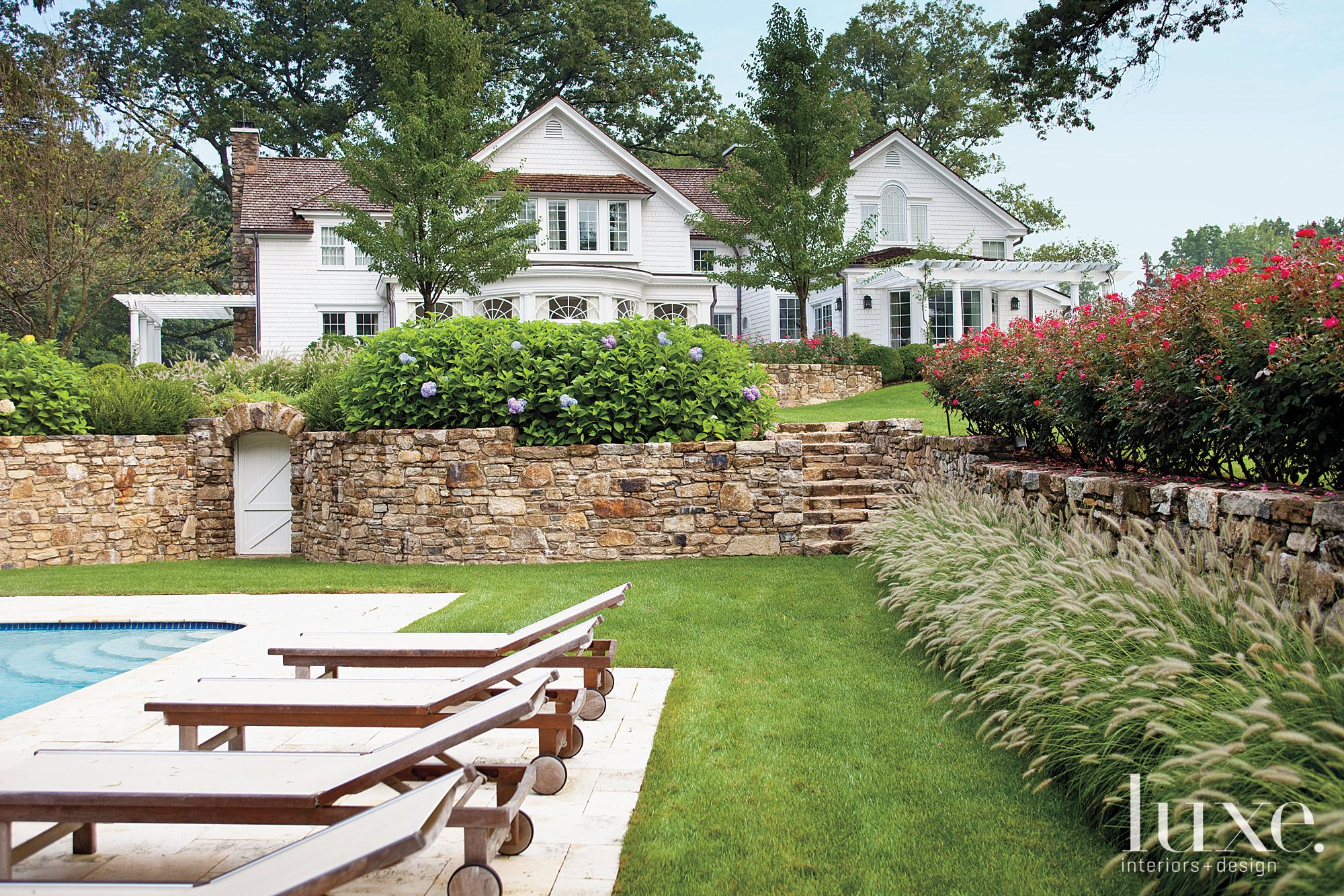 Stone Wall Exterior with Pool