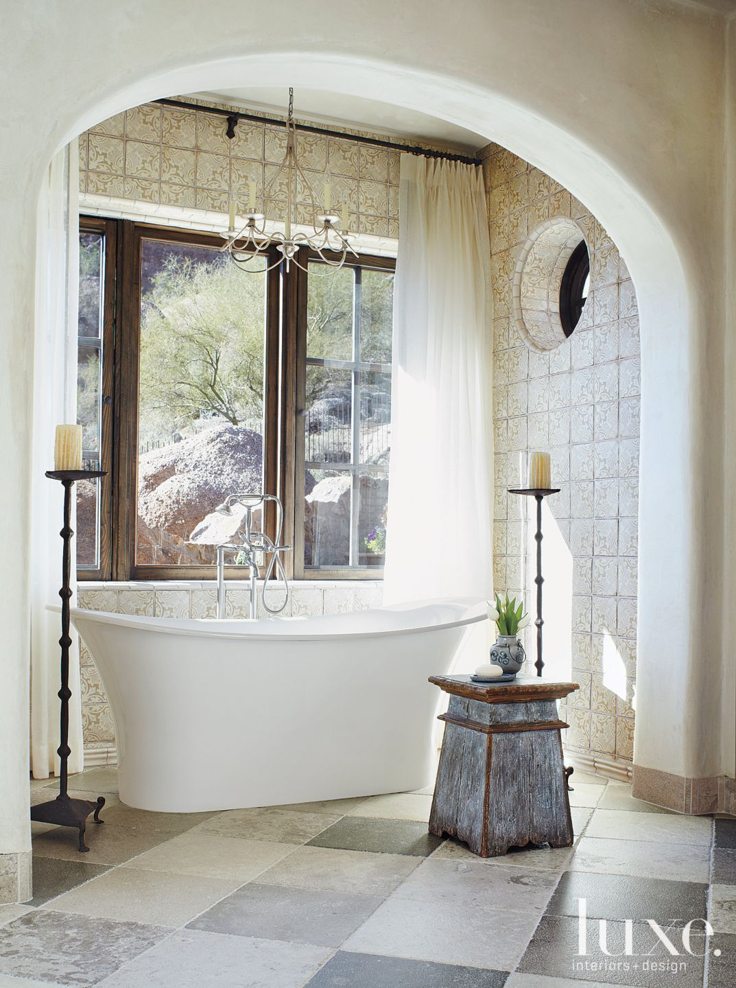 Cream Old-World Bathroom with Freestanding tub