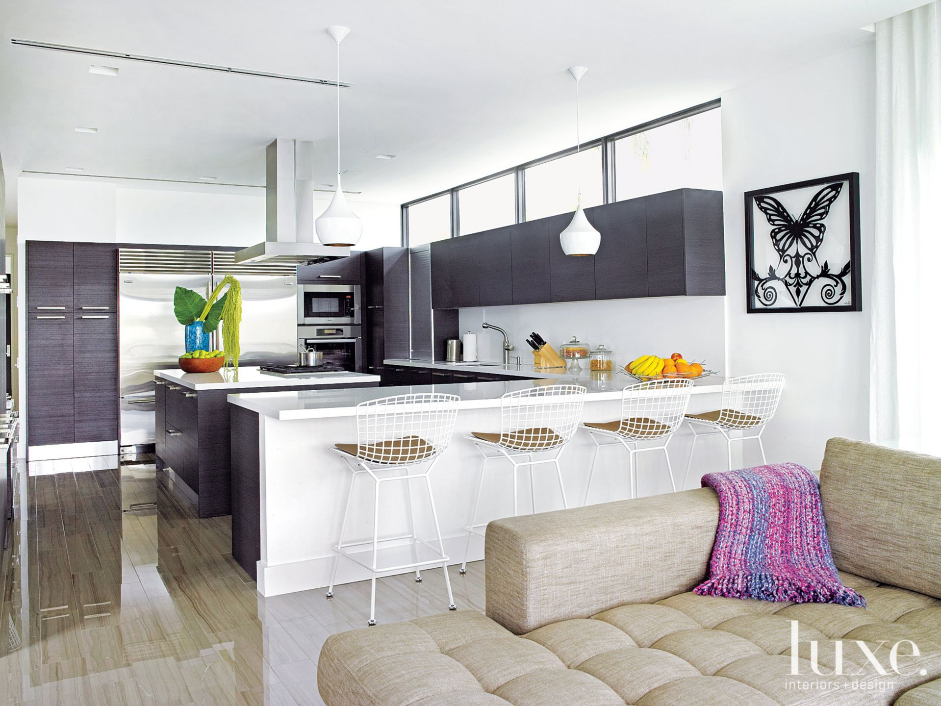 Modern White Kitchen with Black Cabinetry