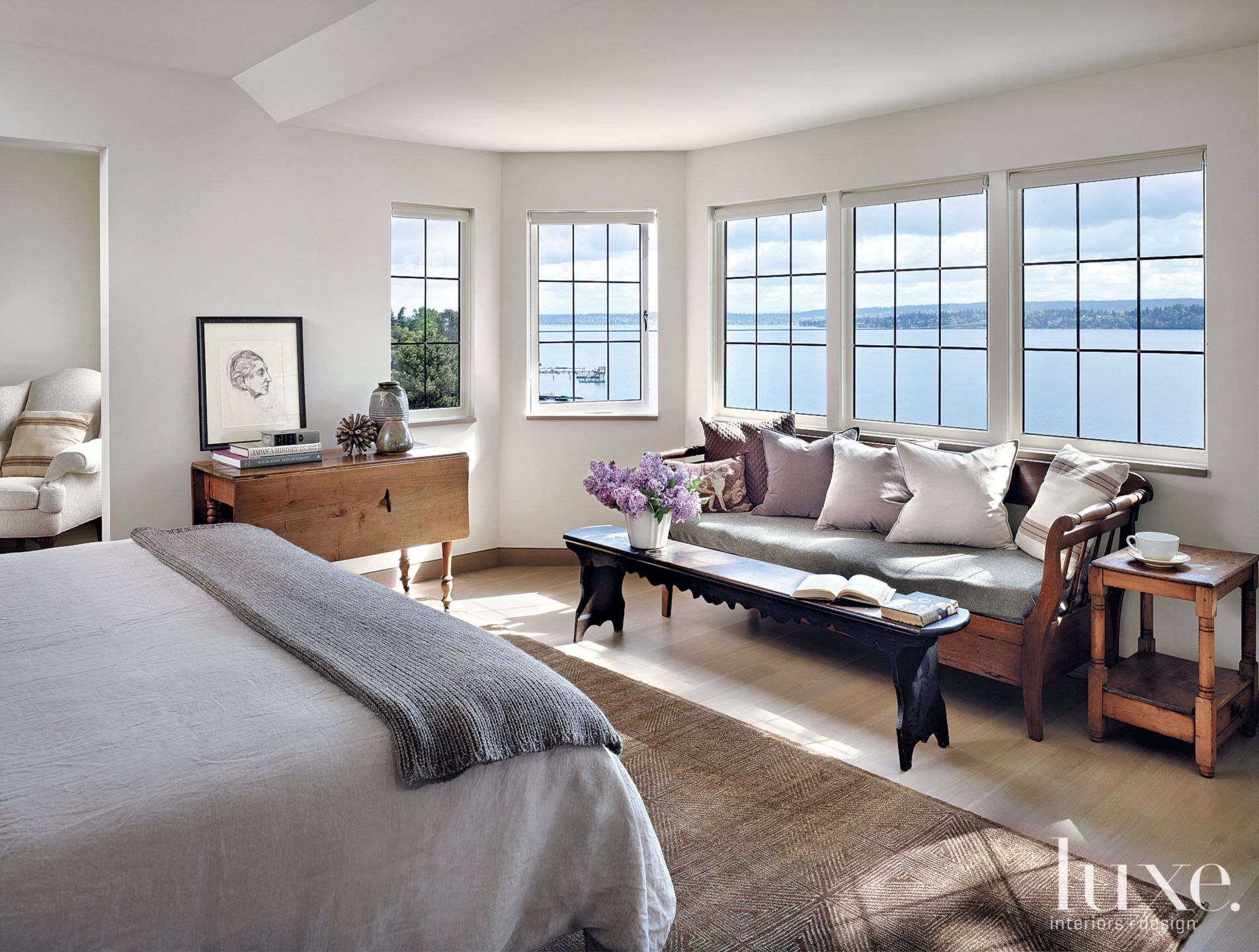 Contemporary White Master Bedroom with Panoramic Lake Views
