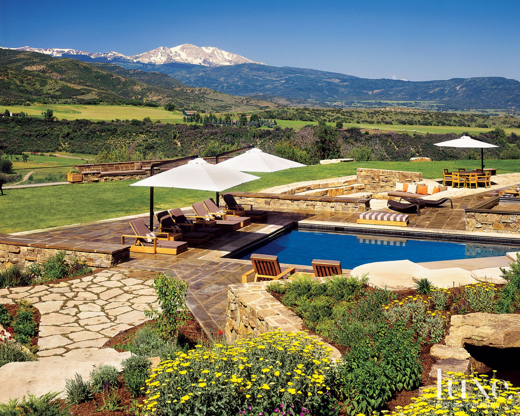 Mountain Neutral Outdoor Pool Area with Indoor-Outdoor Pool