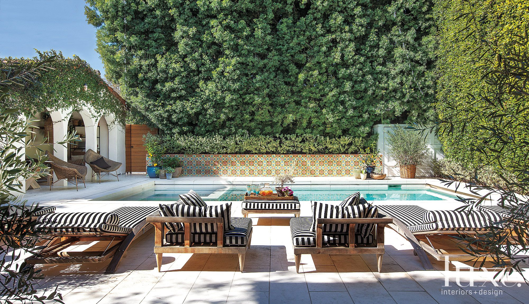 Mediterranean Poolside Terrace with Tile Wall