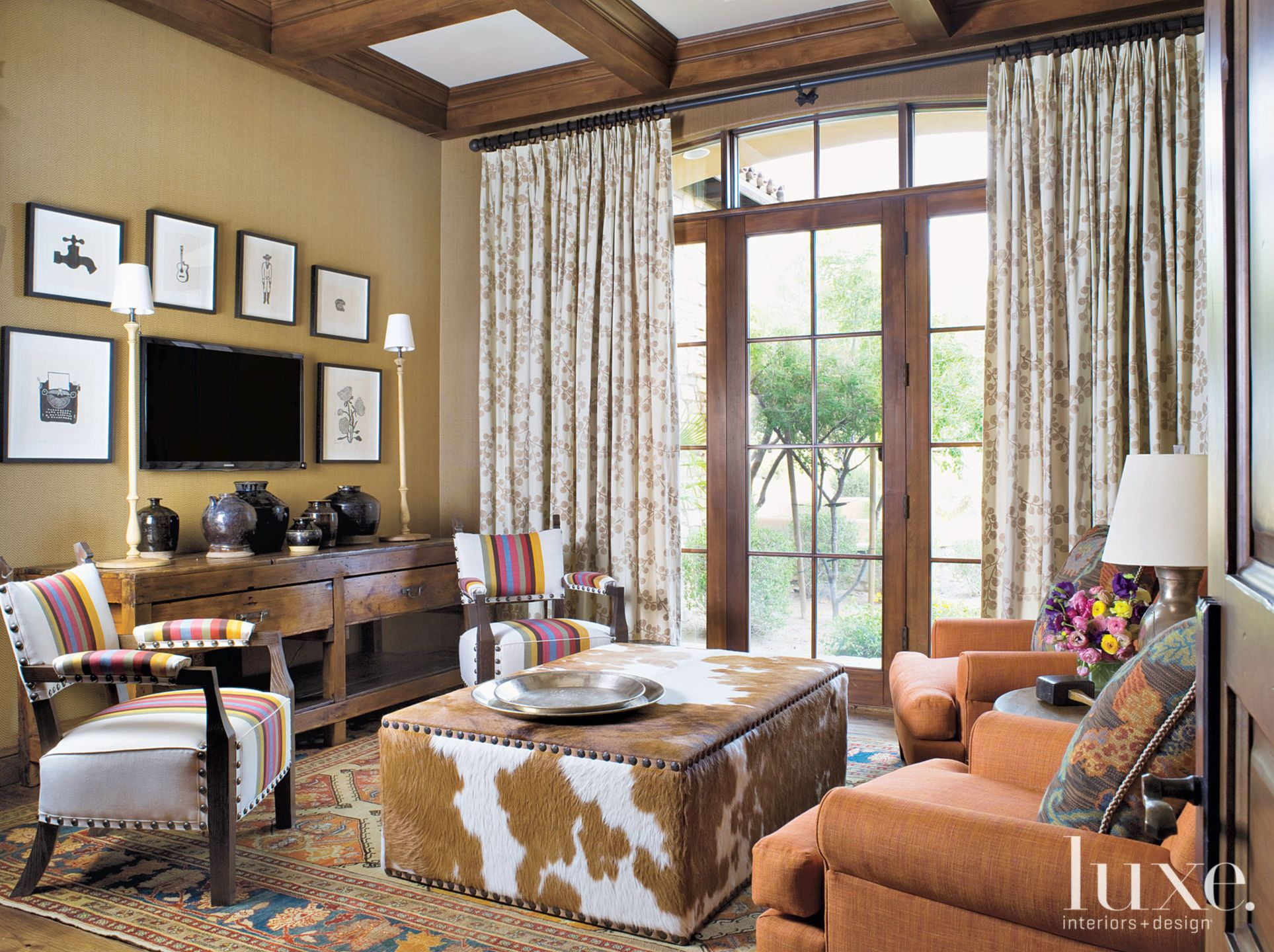 Eclectic Tan Den with Custom Cowhide Ottoman