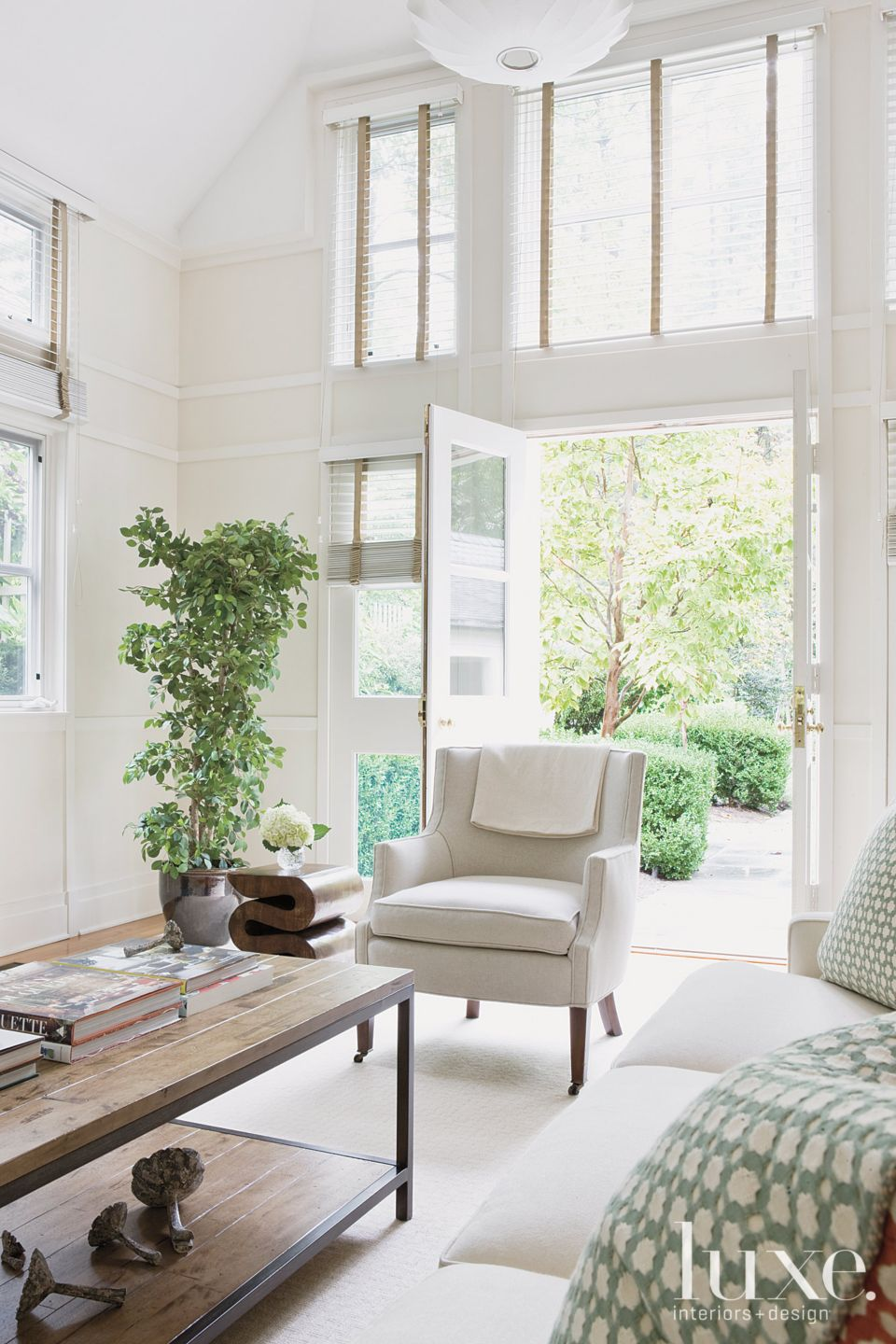 Transitional Cream Living Room with French Doors