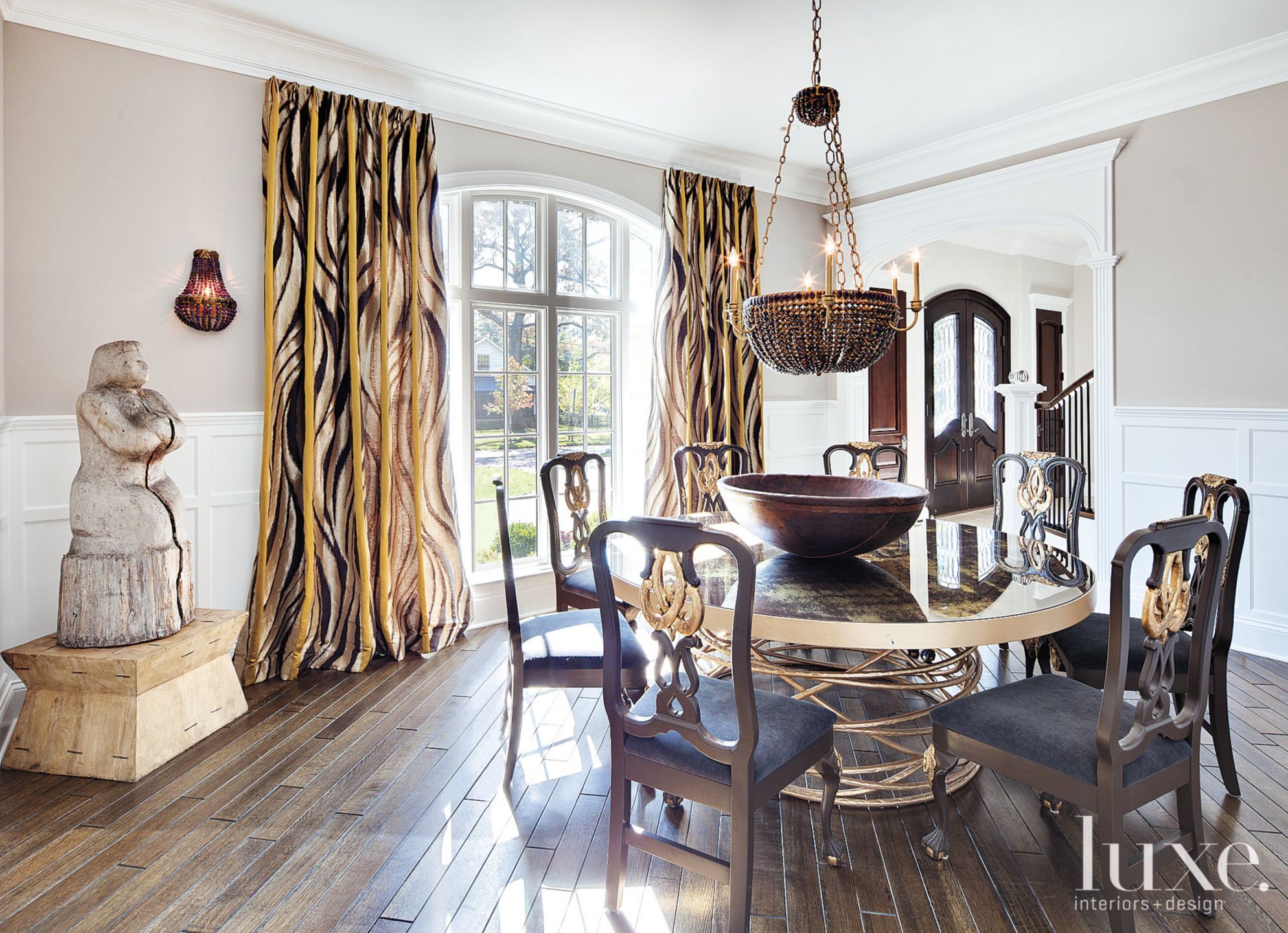 Contemporary Beige Dining Room with Primitive Sculpture