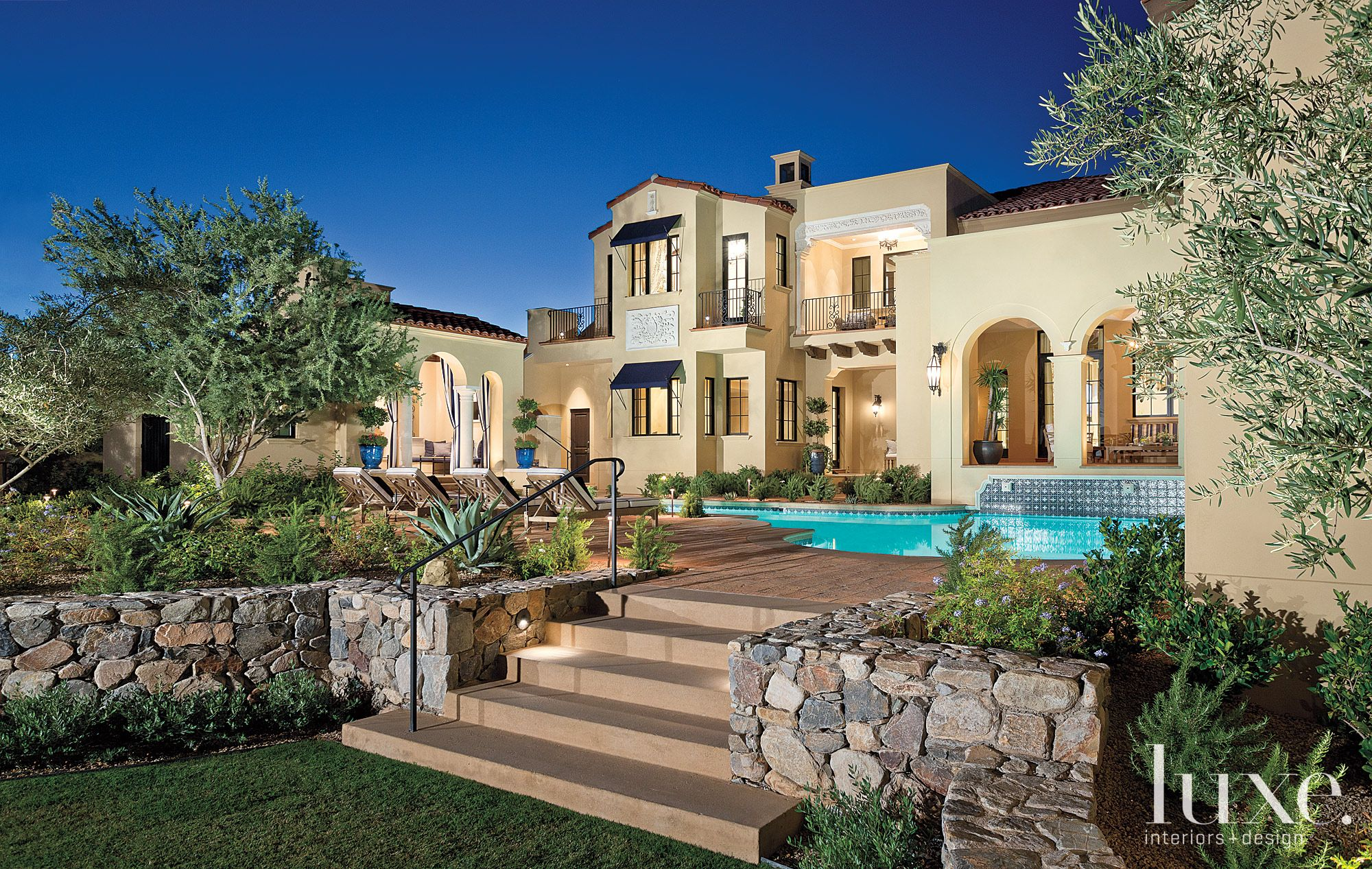 Spanish Colonial Cream Rear Elevation with Stucco Exterior