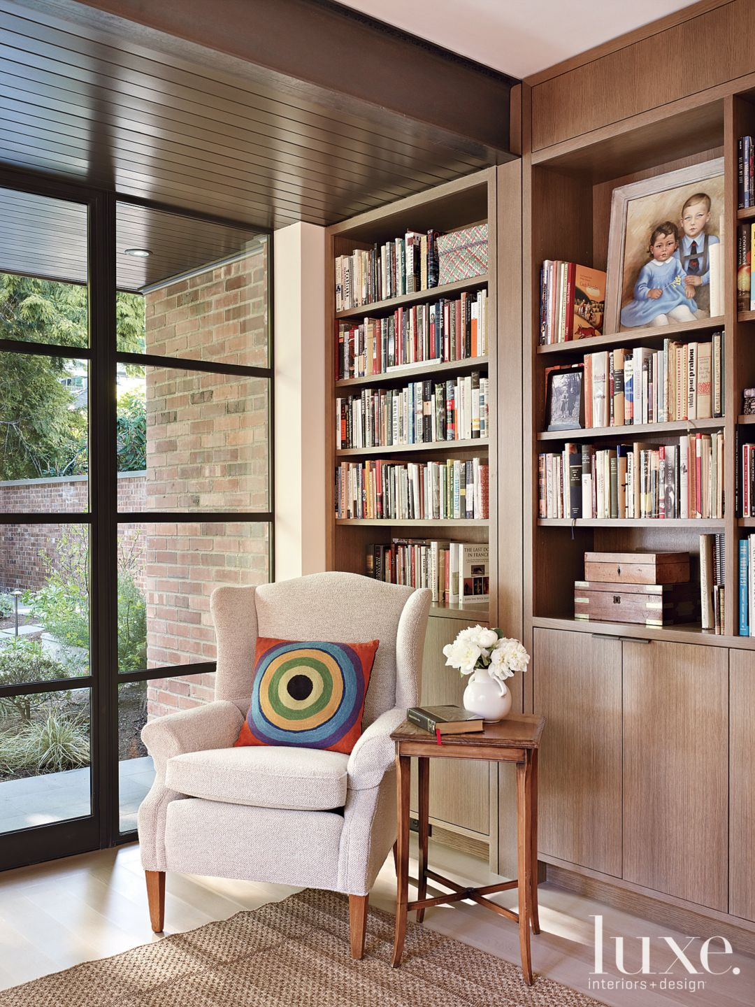 Contemporary Neutral Office Seating with Fabricated Bookshelves