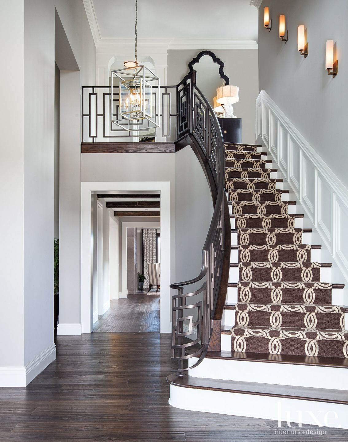 Traditional Staircase with Brown Graphic Carpet