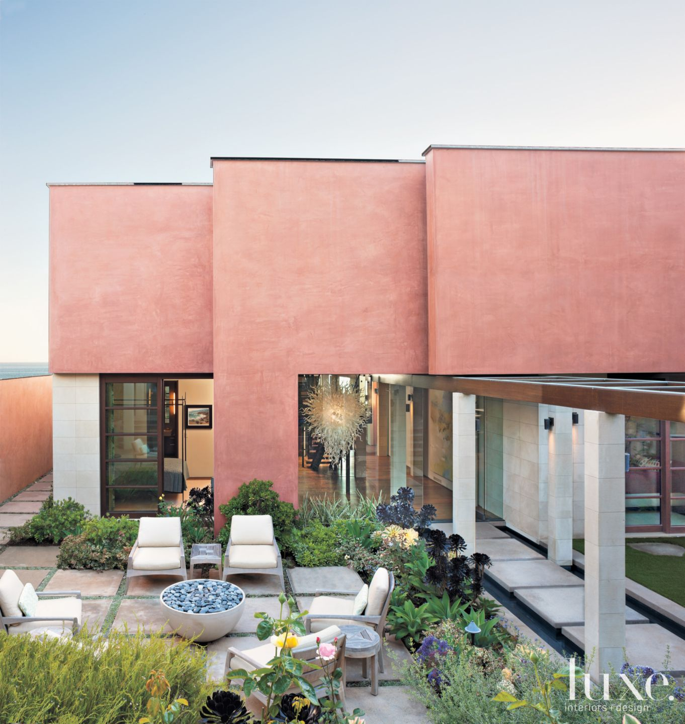 Contemporary Pink Exterior with Glass Panels