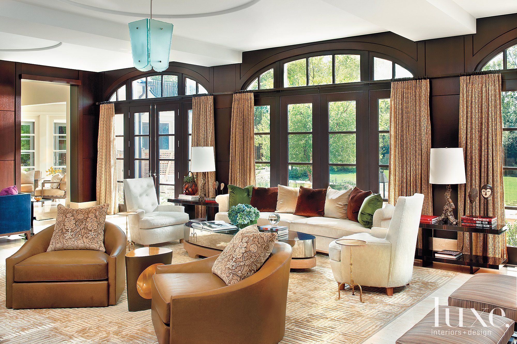 Transitional Brown Great Room with Expansive Arched Windows
